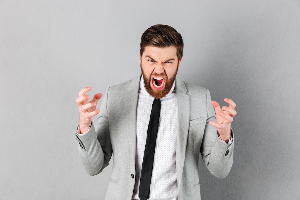 Portrait of a furious businessman dressed in suit